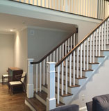 Cape Cod Interior Painting Contractors Exposed wood stairway with white painted banister