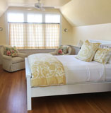 White painted walls and bed with hardwood floor